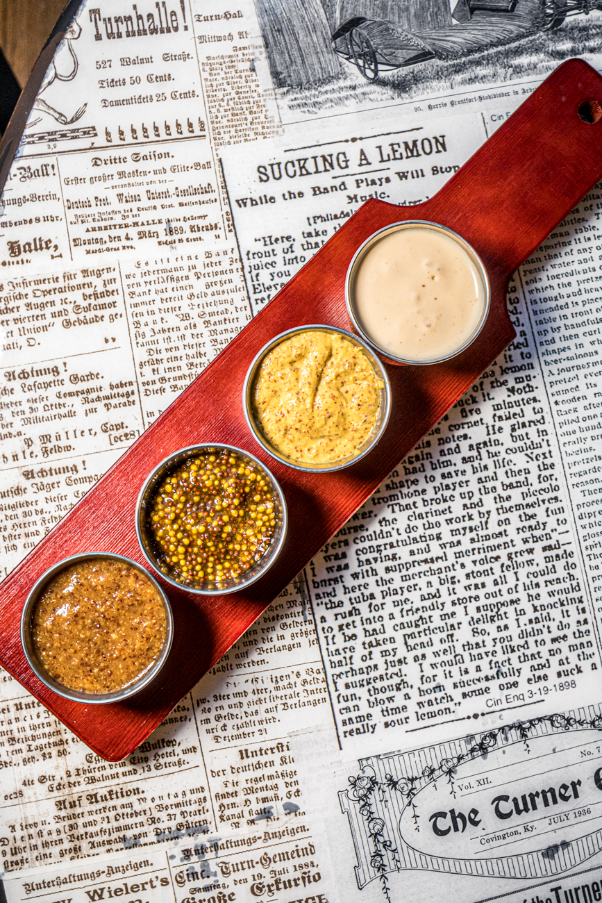 A dip flight of mustards and beer cheese / Image: Catherine Viox{ }// Published: 12.17.19