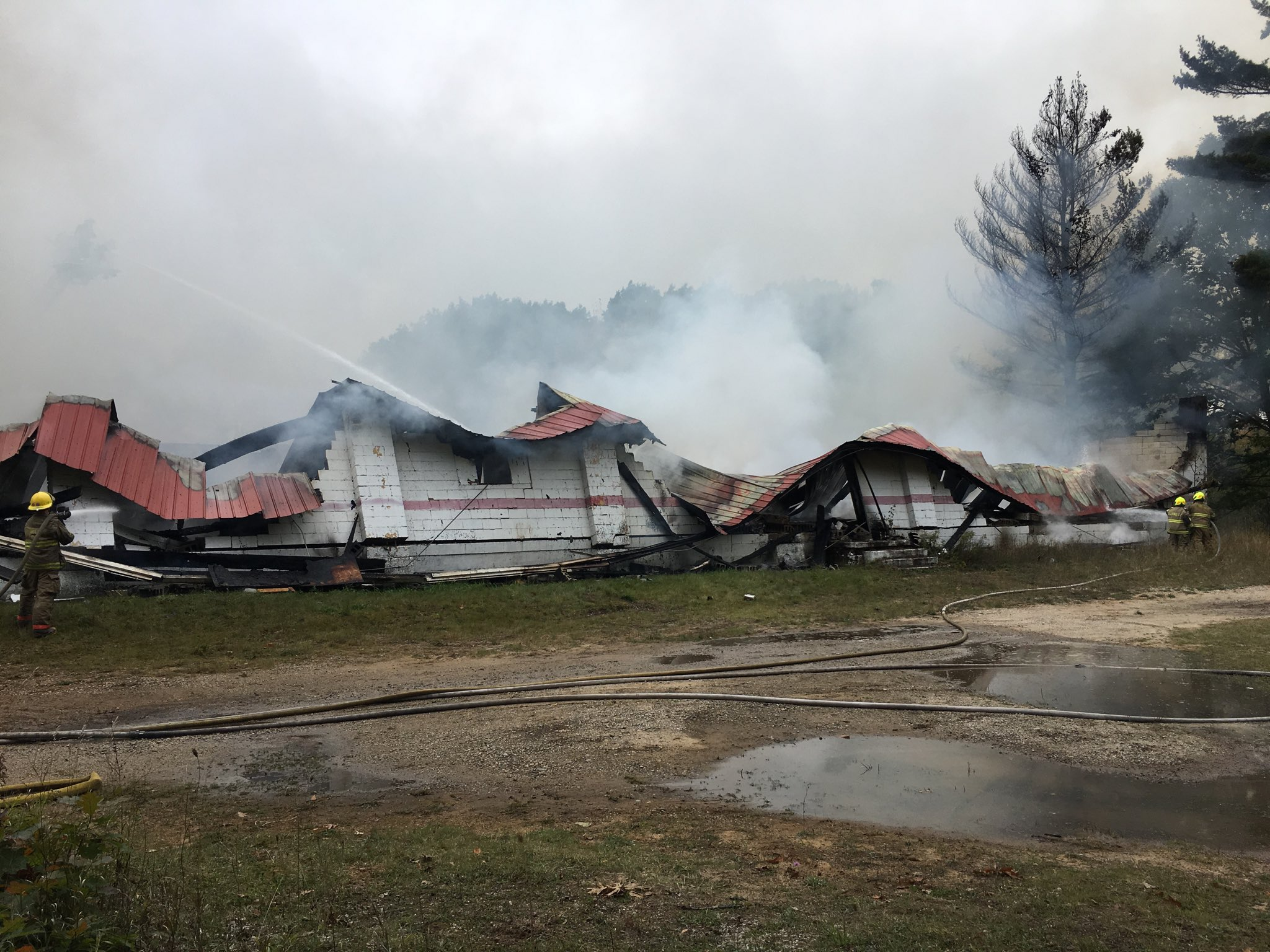 Fire crews are on scene of a fire at a historic skating rink in Cadillac.