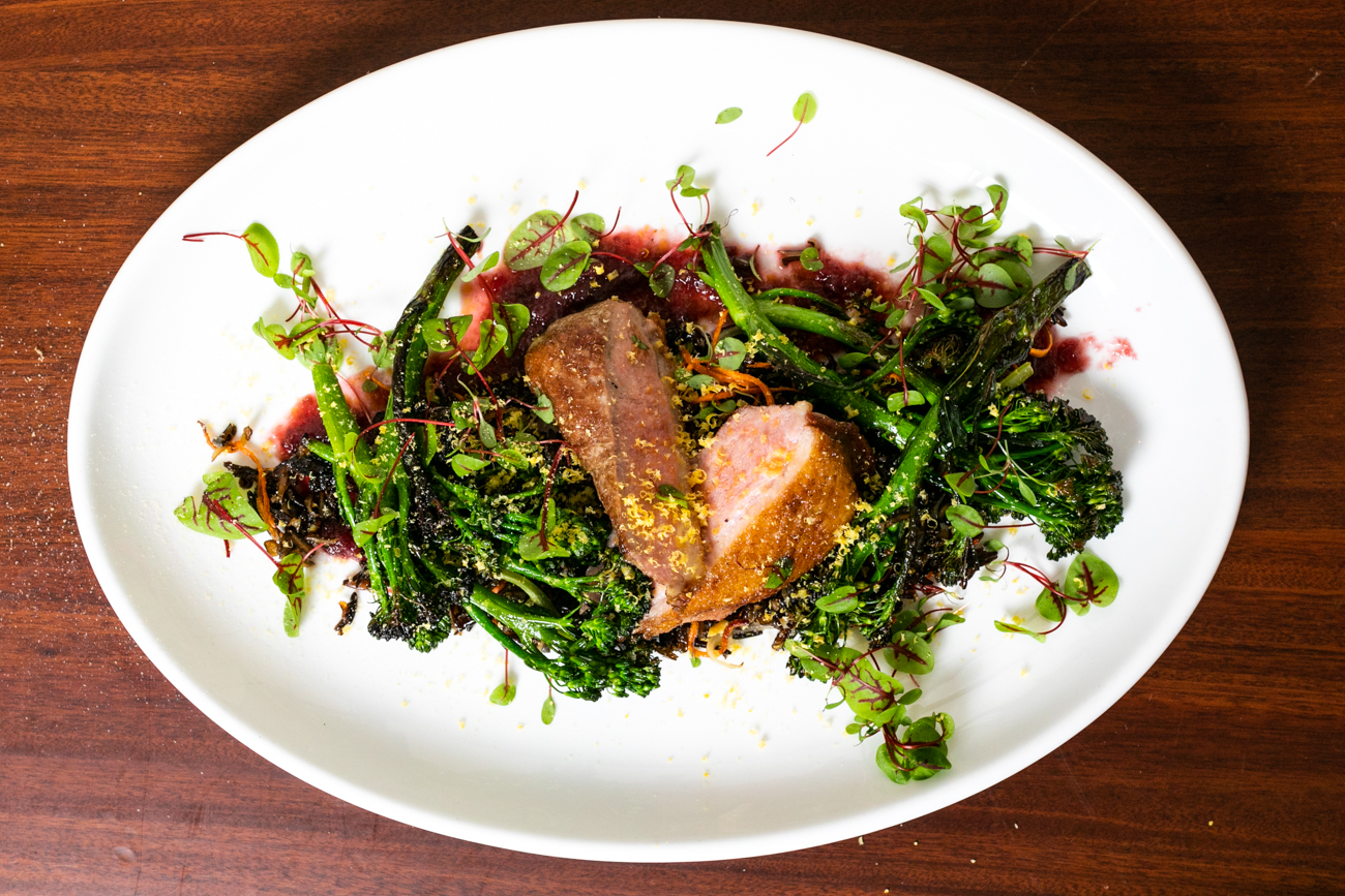 Cast Iron Duck Breast: crispy wild rice, rapini, and grape gelee, topped with cured egg yolk / Image: Amy Elisabeth Spasoff // Published:{ }5.3.19