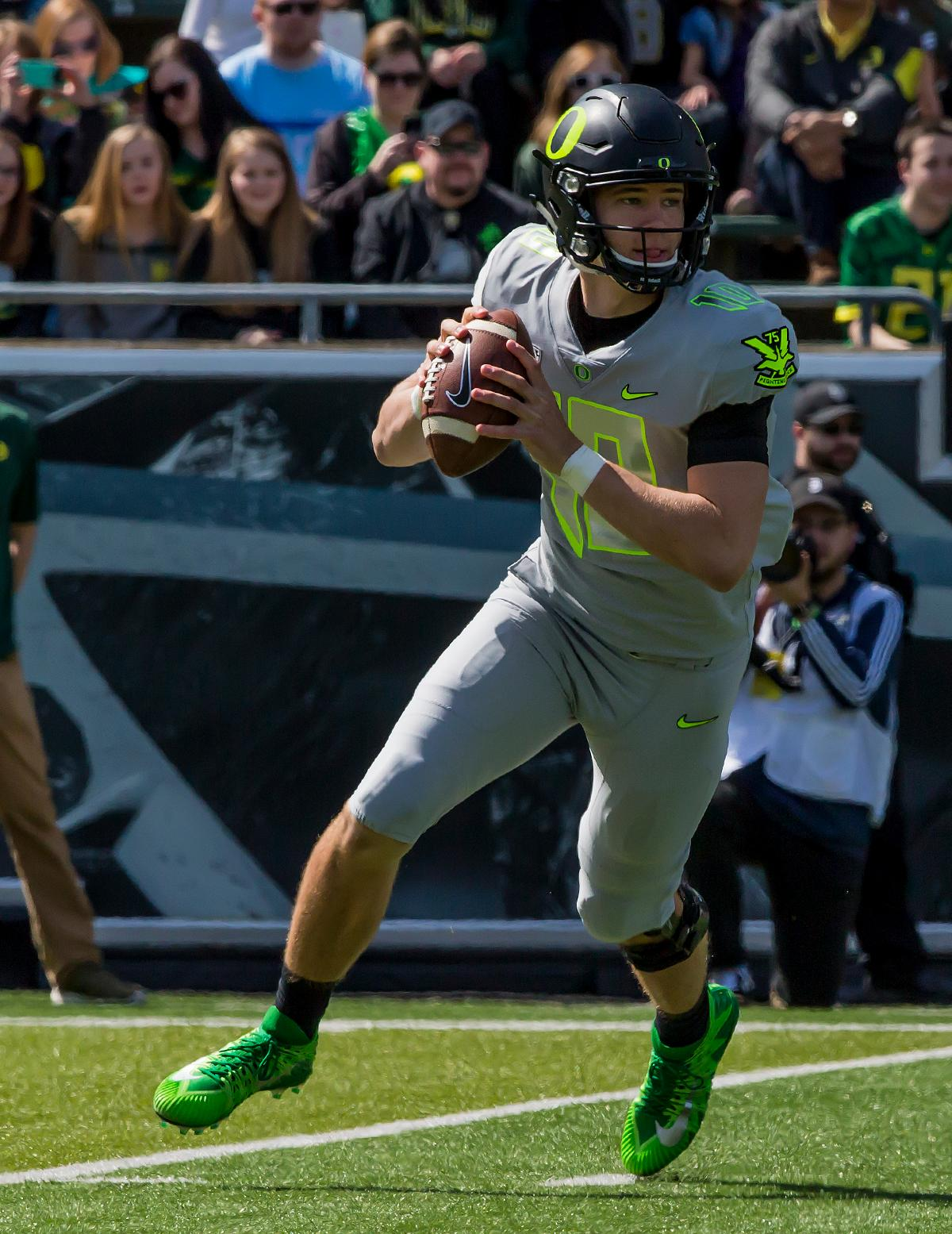 Team Free quarter back Justin Herbert (#10) prepares to pass the ball. The 2017 Oregon Ducks Spring Game provided fans their first glimpse at the team under new Head Coach Willie Taggart's direction. Team Free defeated Team Brave 34-11 on a sunny dat at Autzen Stadium in Eugene, Oregon. Photo by Ben Lonergan, Oregon News Lab