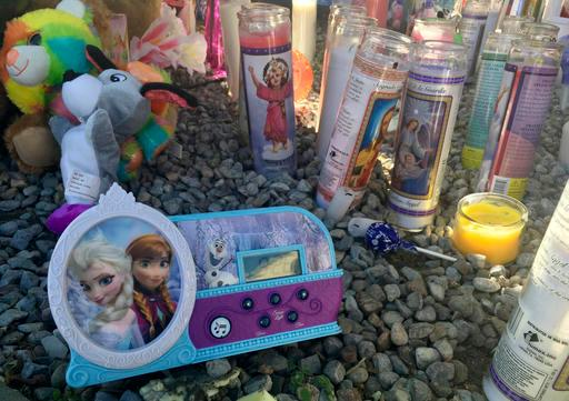 A memorial for a 10-year-old Albuquerque girl who police said was sexually assaulted, strangled then dismembered is shown at an Albuquerque apartment on Friday, Aug. 26, 2016. (AP Photo/Russell Contreras)