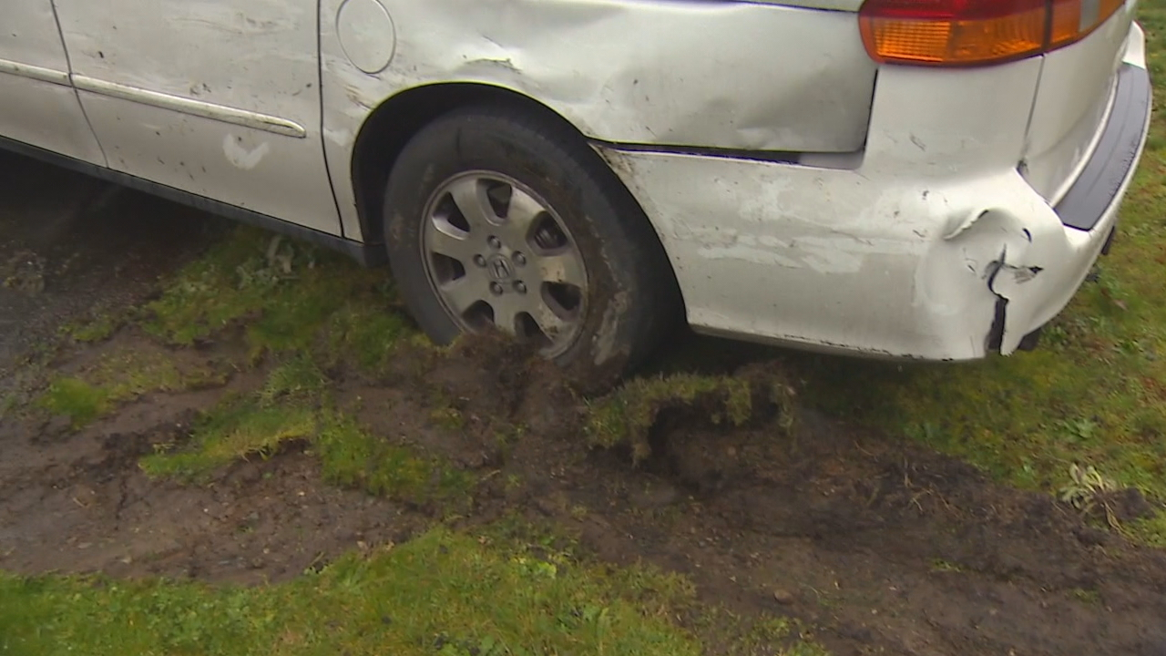 Damaged cars and landscape where a police chase went through an Auburn cul-de-sac (KOMO Photo)