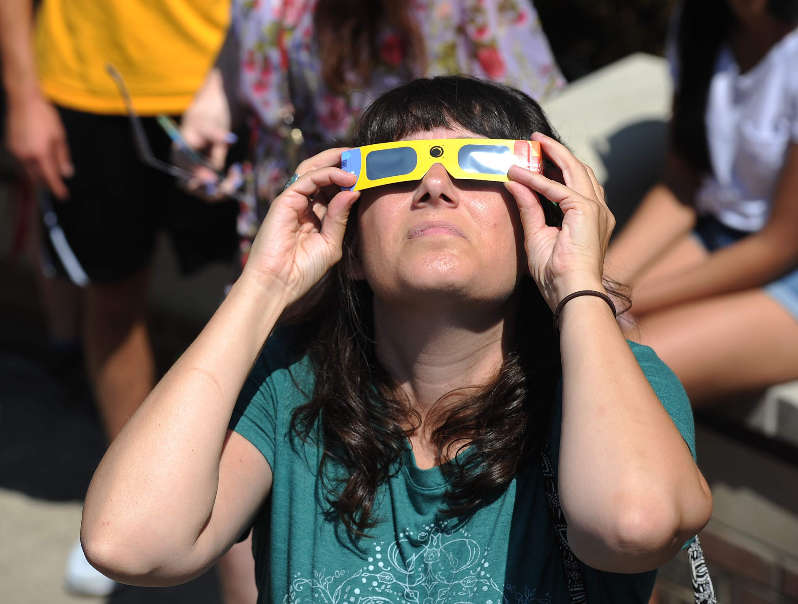 Shannon Fera of Meadville views the solar eclipse Aug. 21 at an eclipse-viewing party held at Penn State Behrend in Harborcreek Township. 'It's a rare phenomenon of nature,' said Fera. 'And we're lucky to be here for it.' Hundreds turned out for the event, which featured telescopes fitted with solar filters available for viewing the partial eclipse. [CHRISTOPHER MILLETTE/ERIE TIMES-NEWS]
