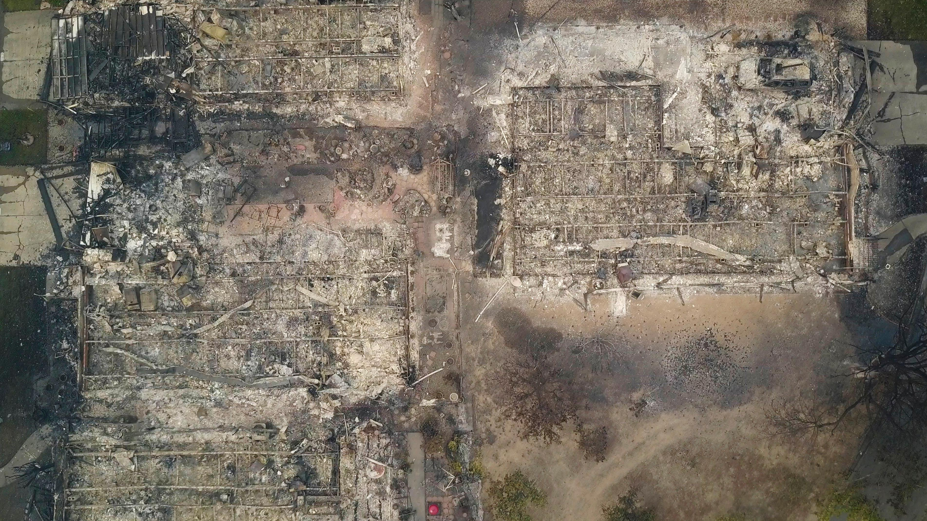 This aerial image shows homes that were destroyed by a wildfire in Santa Rosa, Calif., Tuesday, Oct. 10, 2017. Newly homeless residents of California wine country took stock of their shattered lives Tuesday, a day after deadly wildfires destroyed homes and businesses. (Nick Giblin/DroneBase via AP)