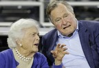 FILE- In this March 29, 2015, photo, former President George H.W. Bush and his wife Barbara Bush speak before the first half of a college basketball game in Houston. The former first lady is promoting literacy on her 90th birthday by lending her backing to a $7 million challenge by X Prize and Dollar General. They?re challenging developers to create a mobile app to help improve adult literacy skills. (AP Photo/David J. Phillip, File)