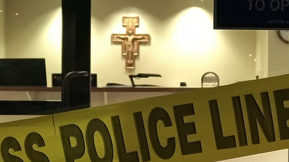 Police remove evidence from Saginaw Catholic Diocese
