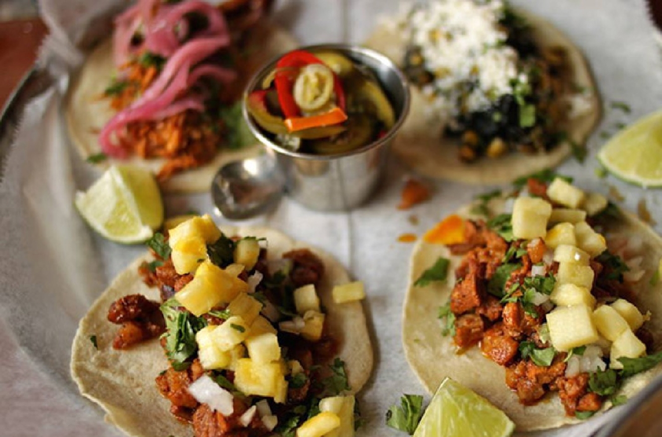 "PLACE: Bakersfield OTR / ADDRESS: 1213 Vine Street (OTR) / EPISODE: Season 21, Episode 6: ""One Street Wonders"" / Get a little tipsy on your next Taco Tuesday with the expansive selection of tequila and craft cocktails at Bakersfield OTR. Then, be like Guy and round out your night with the braised short rib tacos on house-made tortillas or the Milanesa Torta with chicken and black bean spread. / Image courtesy of Bakersfield OTR // Published: 8.18.19"