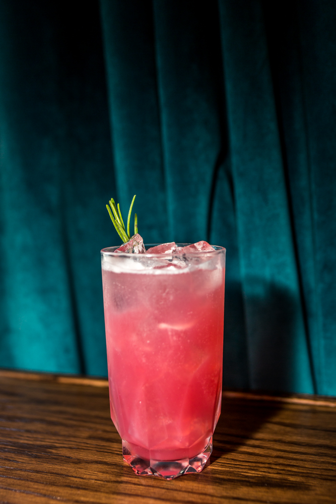 Hi-Rent Fizz: hibiscus and rose petal, red currant infused wódka, rosemary, blackberry, ice cube, and soda / Image: Catherine Viox{ }// Published: 6.28.19