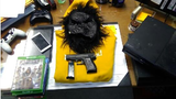 Police: Woman held at gunpoint as suspects in monkey masks steal her property