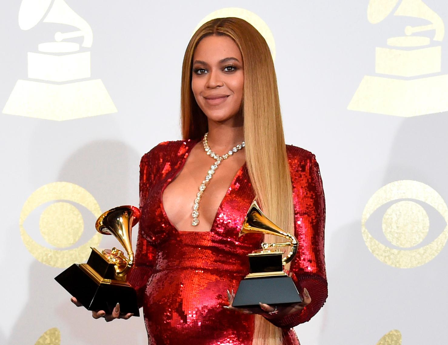 "FILE - In this Feb. 12, 2017 file photo, Beyonce poses in the press room with the awards for best music video for ""Formation"" and best urban contemporary album for ""Lemonade"" at the 59th annual Grammy Awards in Los Angeles.Beyonce paid tribute to historically black colleges during her groundbreaking Coachella performance, and now the singer is donating $100,000 to four black universities. The superstar singer on Monday announced the Homecoming Scholars Award Program for the 2018-2019 academic year through her BeyGOOD initiative. (Photo by Chris Pizzello/Invision/AP, File)"