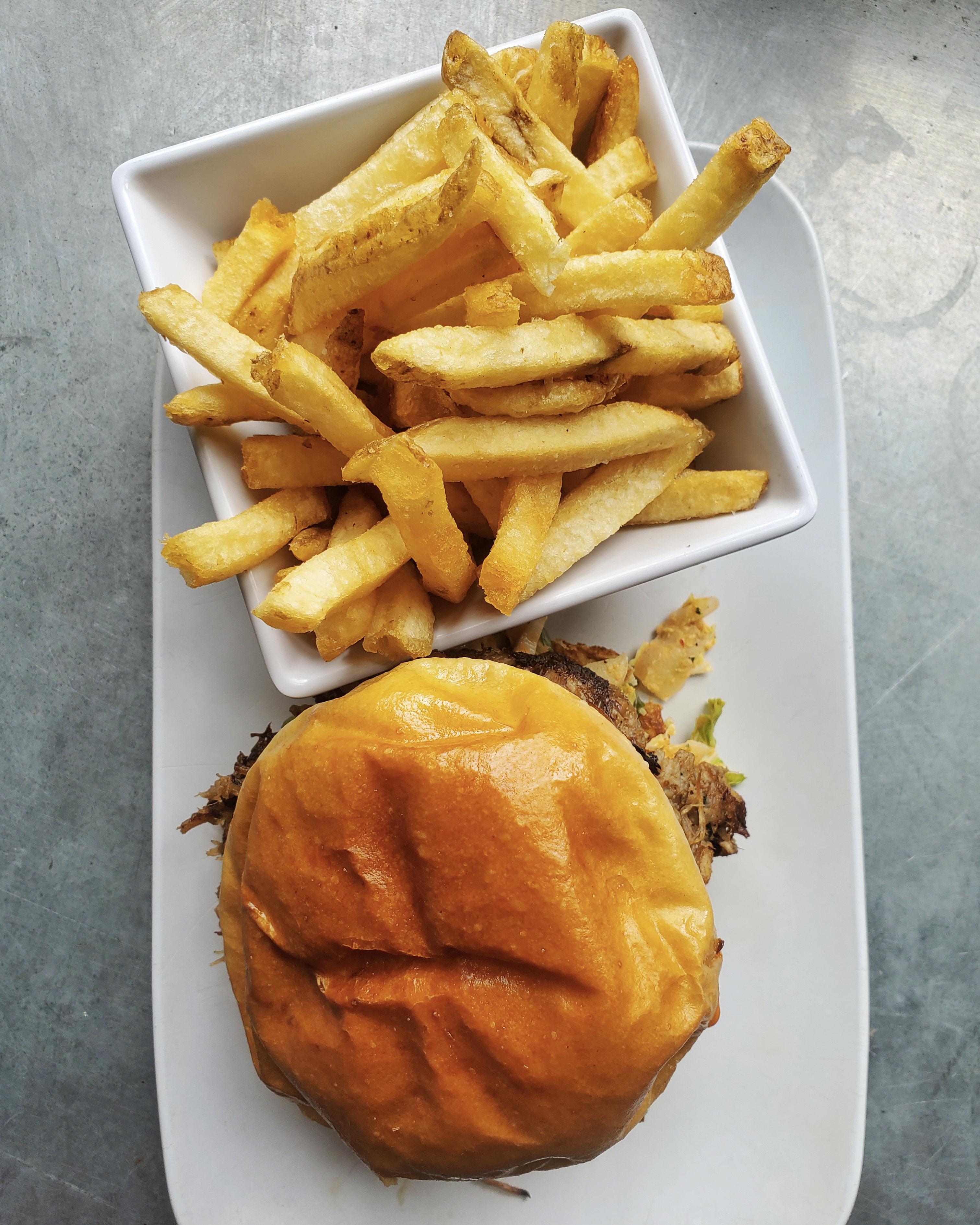 "You've probably heard of{&nbsp;}chef David Chang and his restaurants in New York and beyond. Well,{&nbsp;}<a  href=""http://uneedaburger.com/menu/"" target=""_blank"" title=""http://uneedaburger.com/menu/"">Uneeda Burger in Fremont</a>{&nbsp;}is bringing a bit of it to Seattle with the release of their new sandwich inspired by the uber-popular Korean dish, Bo Ssäm, Chang serves at his{&nbsp;}Momofuku Ssäm Bar in the East Village and elsewhere.{&nbsp;}Uneeda Burger's Pork Bo Ssäm Sandwich ($13) is stacked with{&nbsp;}sweet and savory pulled pork, kimchi slaw, pickled scallion relish and Bo Ssäm sauce. Add fries, a green salad or cheese curds on the side for an additional cost.{&nbsp;}Uneeda Burger is open for takeout, and{&nbsp;}<a  href=""https://direct.chownow.com/order/10126/locations/13876"" target=""_blank"" title=""https://direct.chownow.com/order/10126/locations/13876"">you can order exclusively online{&nbsp;}here</a>. (Image:{&nbsp;}Photos courtesy of Uneeda Burger / Justin Oba){&nbsp;}"