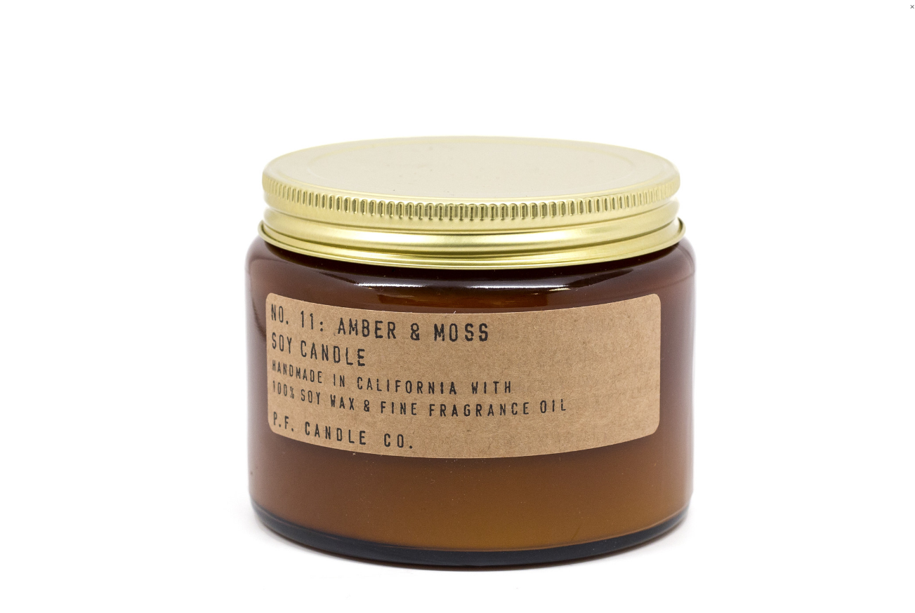 AMBER + MOSS CANDLE Designer: P.F. Candle Co. from Moorea Seal Collection ($27.99). Find on mooreaseal.com. (Image courtesy of Moorea Seal Store)