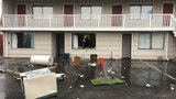 Police: Man armed with 3 axes destroys Edmonds motel room, threatens to kill guests