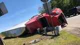 Tractor trailer rolls over after driver avoids deer in Hollis