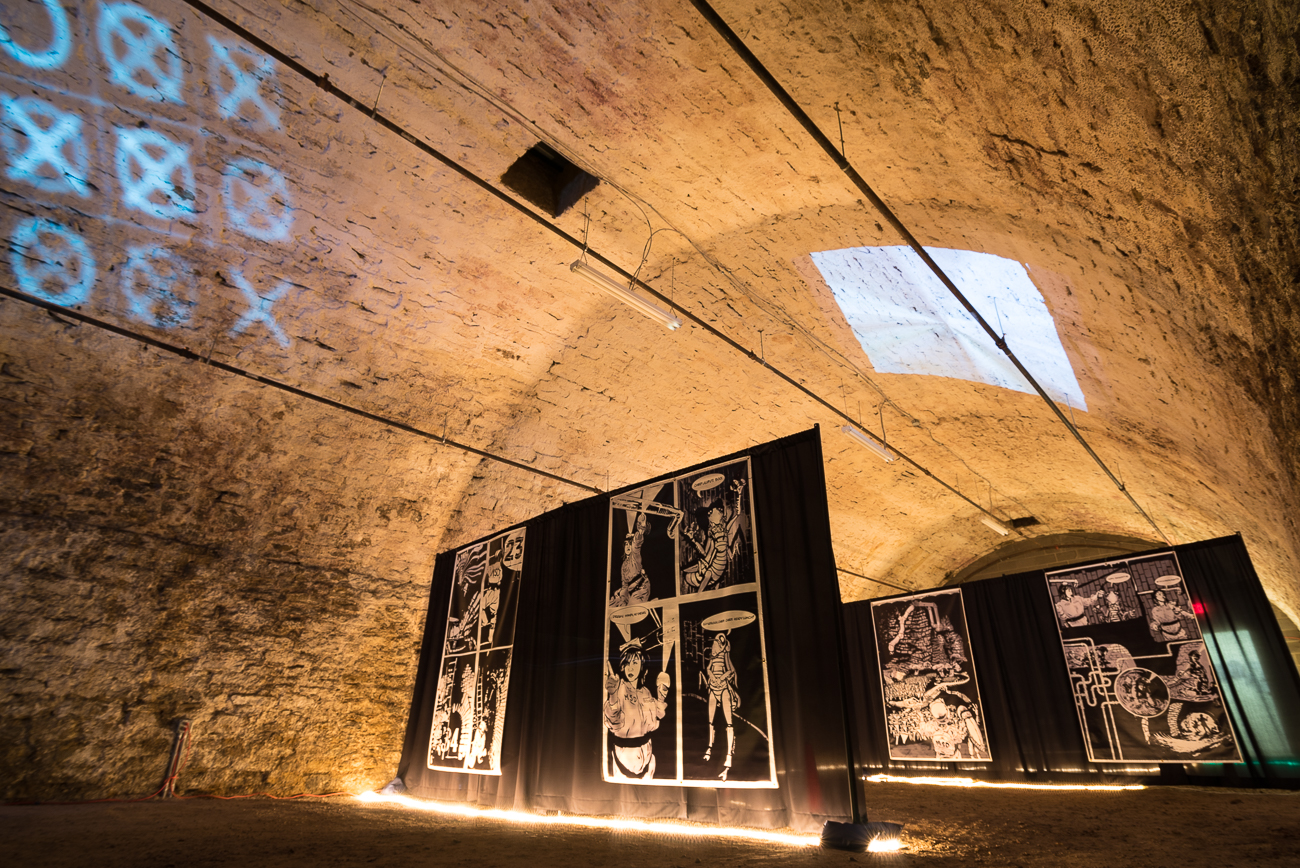 Two local artists used a cellar under Union Hall for an immersive comic book experience. The MeSseD Tunnel Tour brings visitors into the cellar to read the 8-foot-high comic book panels. Appropriately, the comic follows the exploits of a sewer worker who runs into some unexpected (and unwelcome) company within a city's underground tunnels. / Image: Phil Armstrong, Cincinnati Refined // Published: 6.14.18