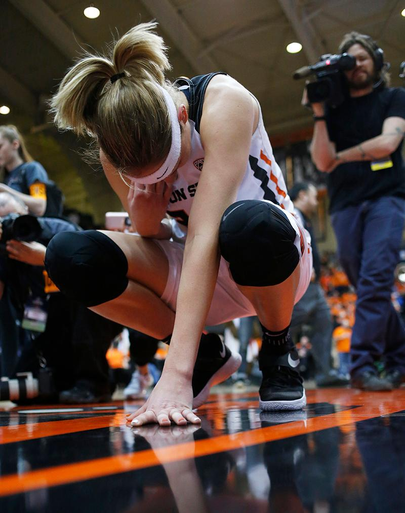 Oregon State's Sydney Wiese touches center court after Oregon State defeated Creighton 64-52 in a second-round game in the NCAA women's college basketball tournament Sunday, March 19, 2017, in Corvallis, Ore., in Wiese's final game at Gill Coliseum. (AP Photo/Timothy J. Gonzalez)