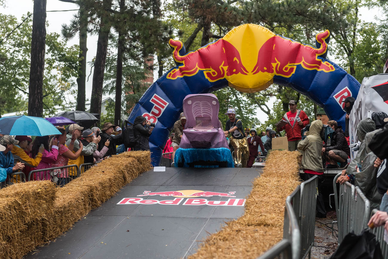 <p>The RedBull Soapbox Race was (kind of) held on Saturday, September 8. Over 50 non-motorized, human-powered racing cars sporting different designs were ready to speed downhill through Eden Park. Unfortunately, due to rainy conditions, only 26 teams were able to compete. RedBull has held 100+ soapbox races around the world over the last 18 years; this year's event was Cincinnati's third soapbox race. / Image: Mike Menke // Published: 9.9.18<br></p>