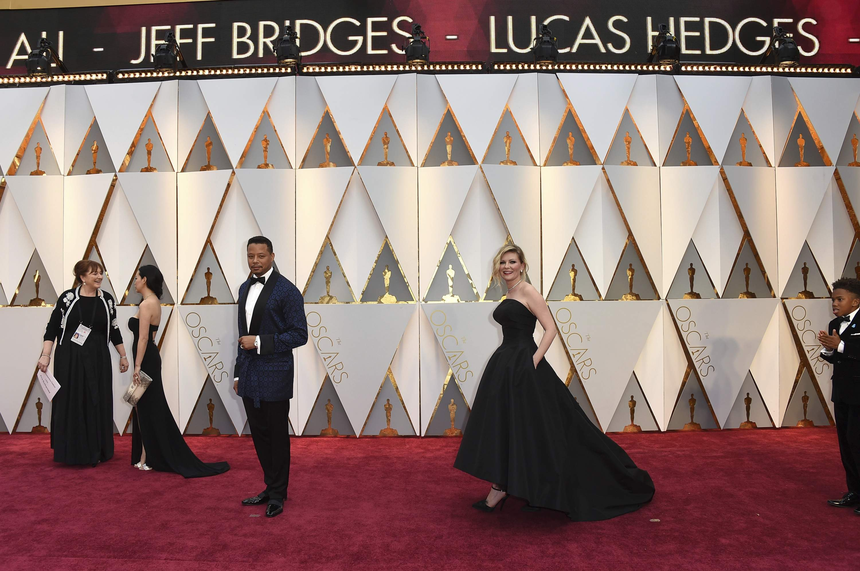 Terrence Howard, center left, and Kirsten Dunst arrive at the Oscars on Sunday, Feb. 26, 2017, at the Dolby Theatre in Los Angeles. THE ASSOCIATED PRESS