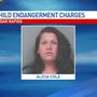 Mother who drove into Cedar River charged with child endangerment