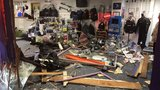 Slick roads blamed as driver crashes into Des Moines diving store