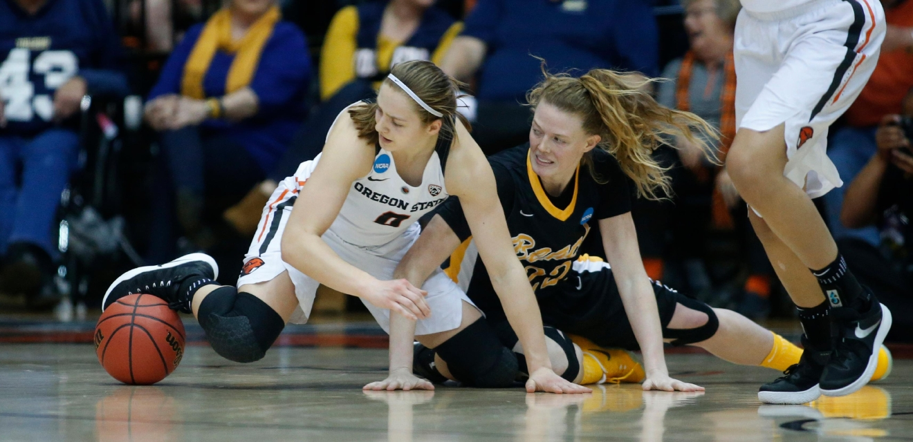 Oregon State's Mikayla Pivec (0) and Long Beach State's Madison Montgomery (22) hit the floor chasing a loose ball during the second half of a first-round game in the women's NCAA college basketball tournament Friday, March 17, 2017, in Corvallis, Ore. (AP Photo/ Timothy J. Gonzalez)