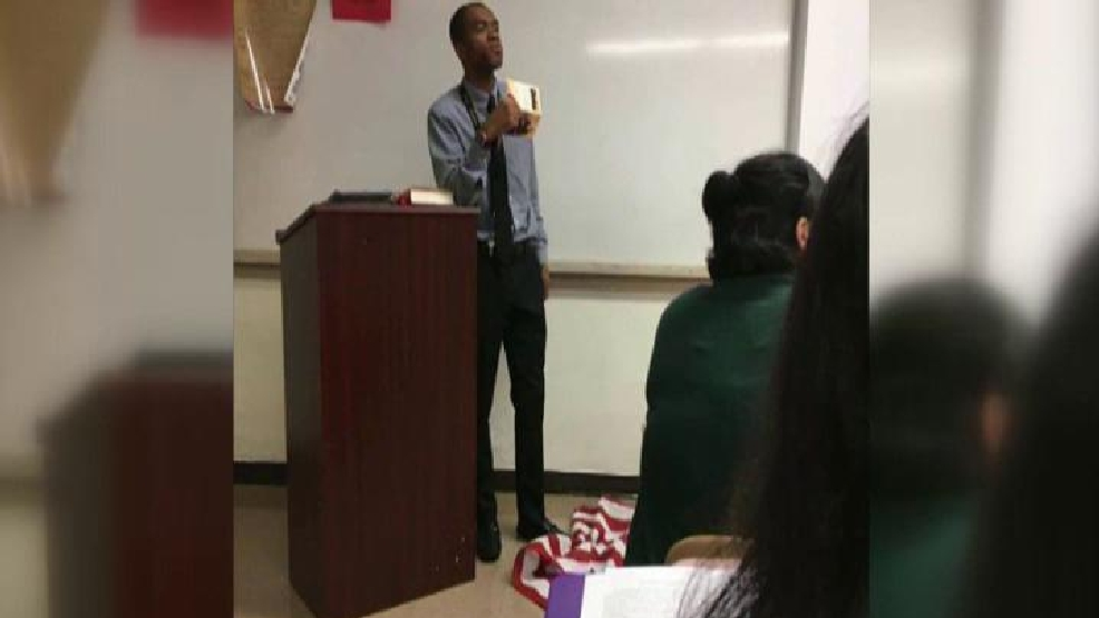 teacher stomps on flag