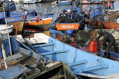 Fishing boats damaged by a small tsunami, sit in Caleta Riquelme, adjacent to the port, in the northern town of Iquique, Chile, after magnitude 8.2 earthqauke struck the northen coast of Chile, Wednesday, April 2, 2014.