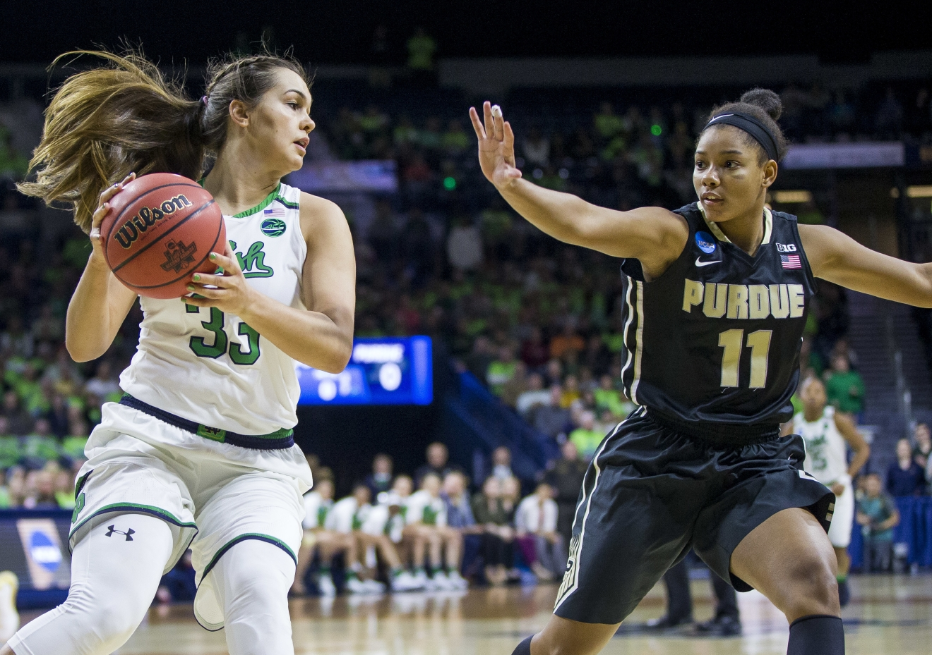 Notre Dame's Kathryn Westbeld (33) looks to pass around Purdue's Dominique Oden (11) during a second-round game in the NCAA women's college basketball tournament, Sunday, March 19, 2017, in South Bend, Ind. (AP Photo/Robert Franklin)