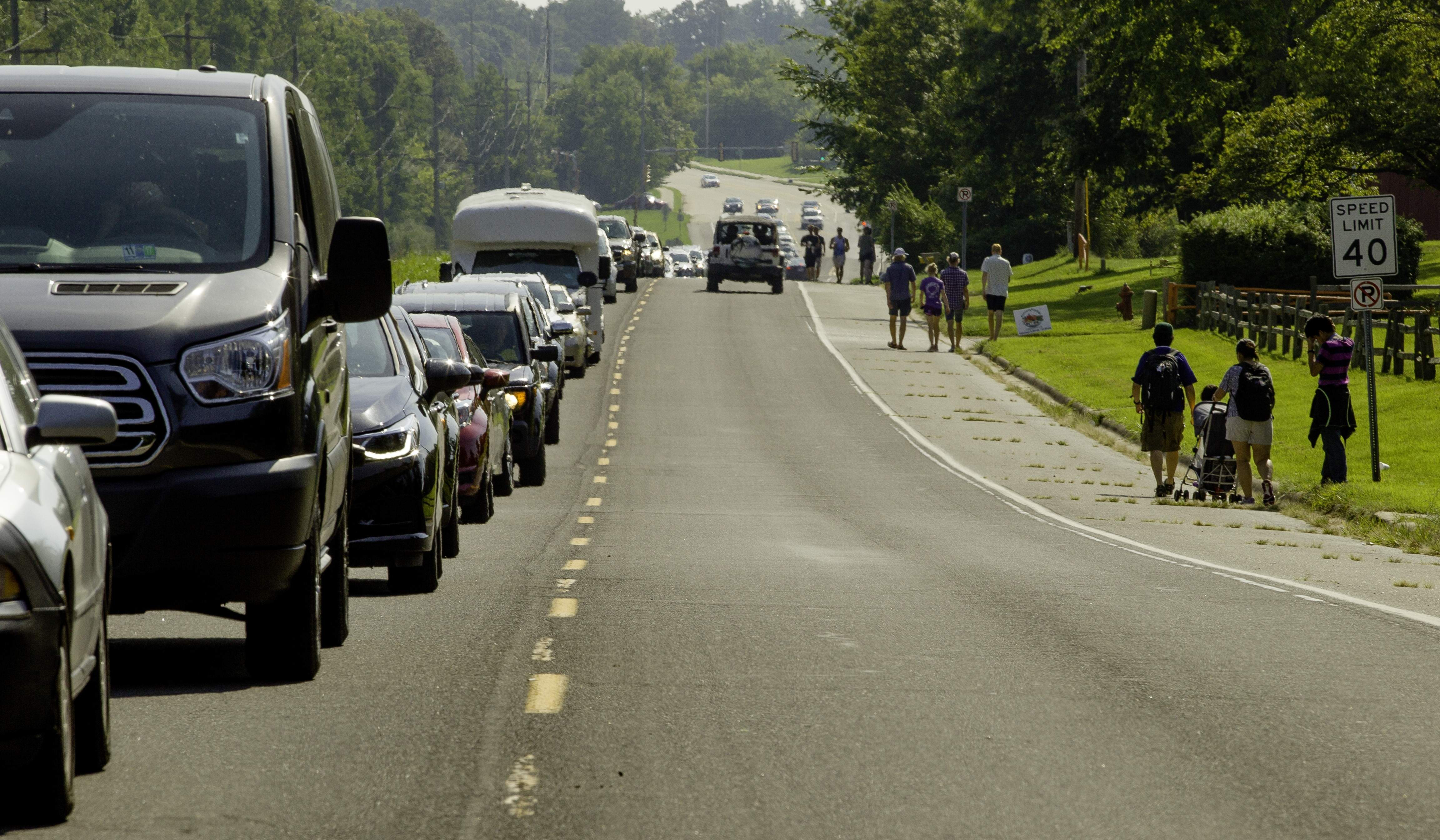 Traffic slows down on Pleasant Hill Road in Carbondale as people arrive to view the total solar eclipse Monday, Aug. 21, 2017. [Ted Schurter/The State Journal-Register]