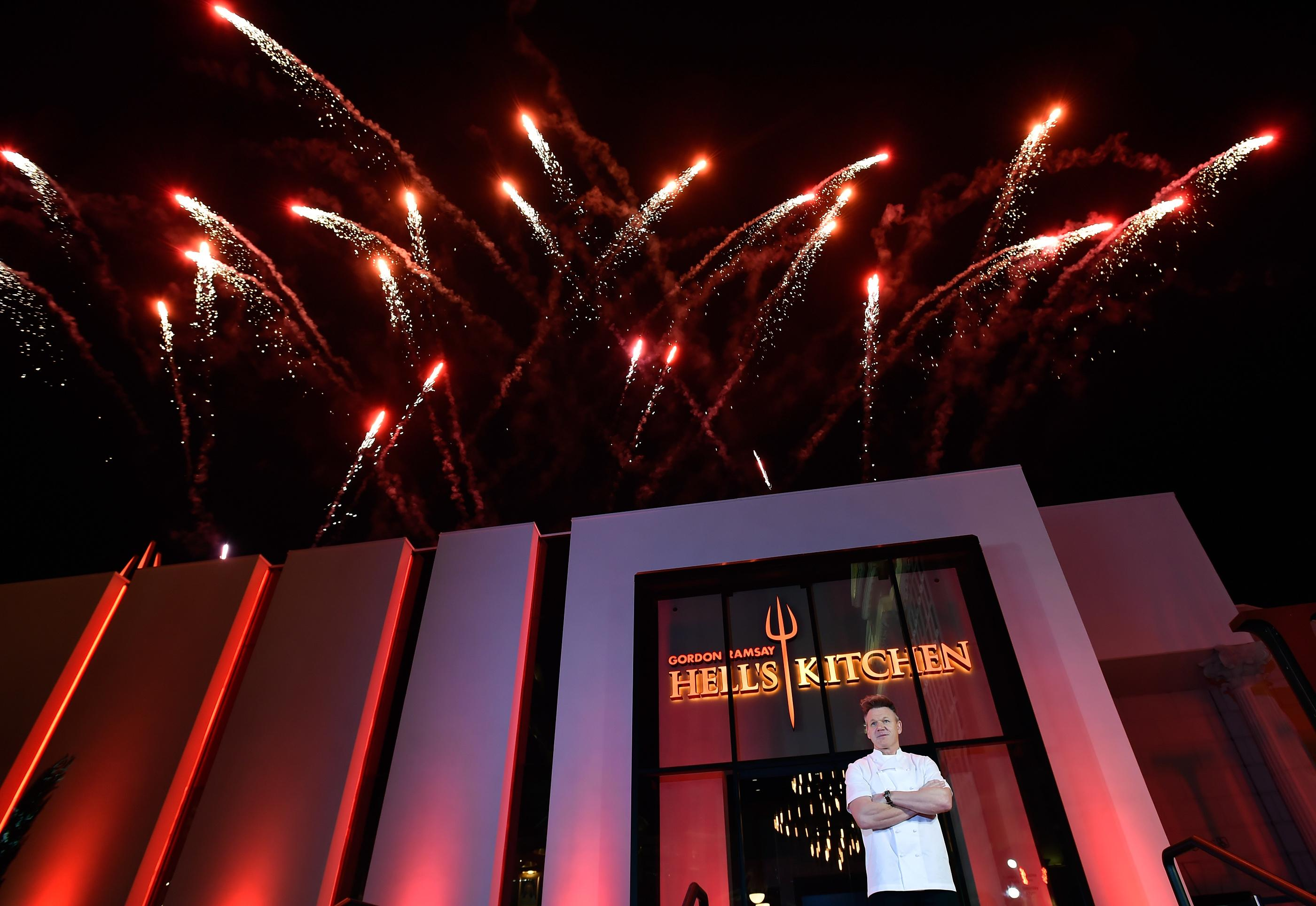 Fireworks explode as chef Gordon Ramsay poses during the grand opening of Gordon Ramsay Hell's Kitchen at Caesars Palace Friday, Jan. 26, 2018, in Las Vegas. CREDIT: David Becker/Las Vegas News Bureau