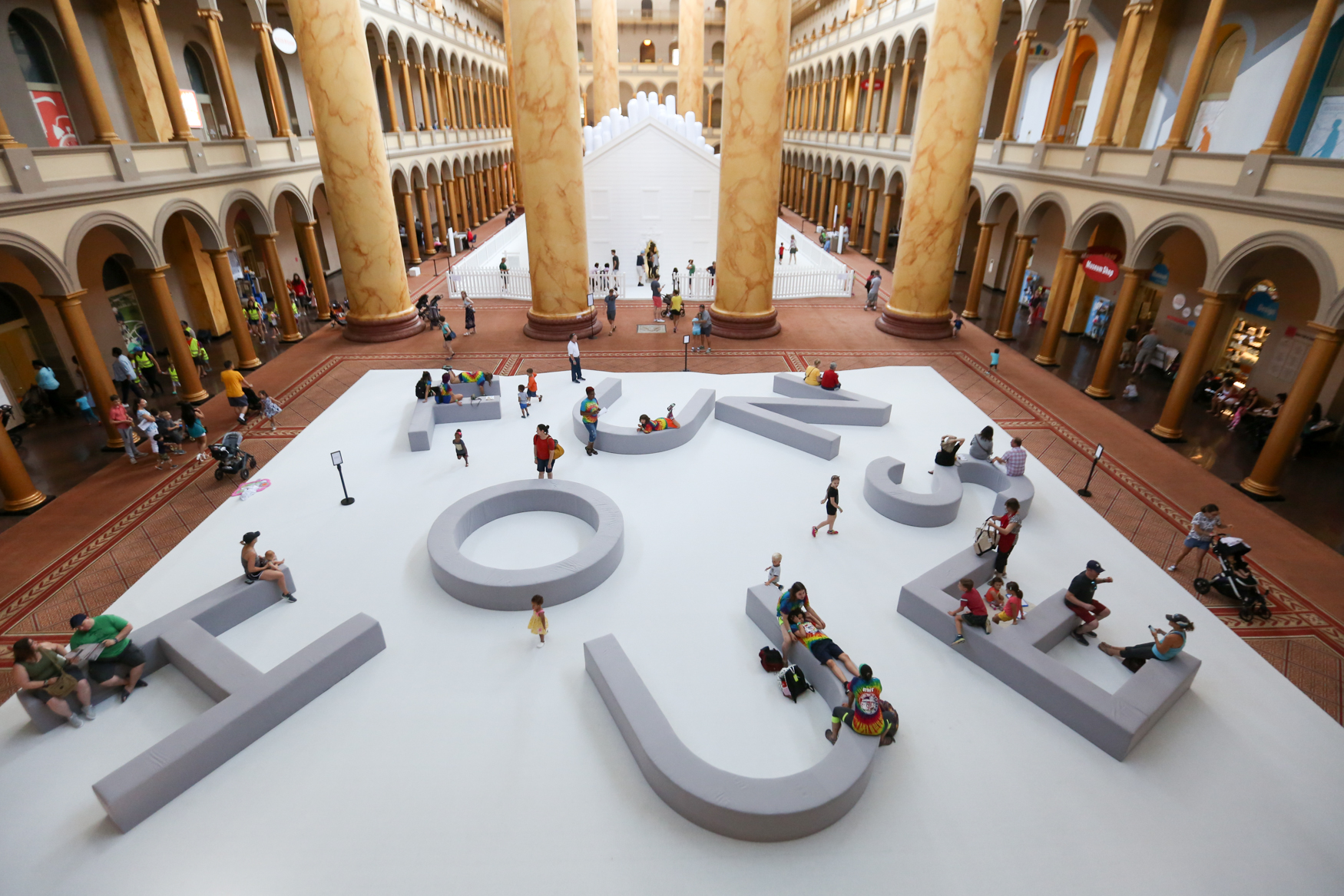 If you can't make it to a real pool, a super-Instagrammable pool filled with balls is a good alternative. Fun House, the National Building Museum's summer exhibit, features a giant house with an ice cave-like room made of white styrofoam in addition to the all-white pool area. (Amanda Andrade-Rhoades/DC Refined)